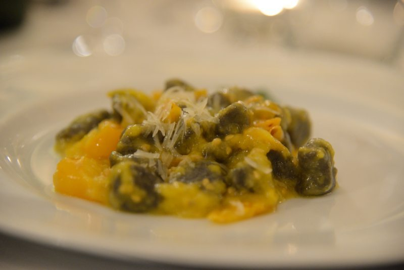Gnocchetti di farina di grano arso con pomodorini gialli del Vesuvio e scaglie di Asiago vecchio DOP